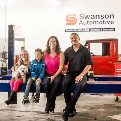 Swanson family in Swanson Auto shop