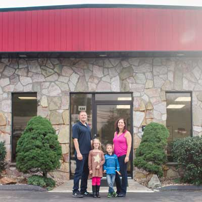Swanson Family outside of shop